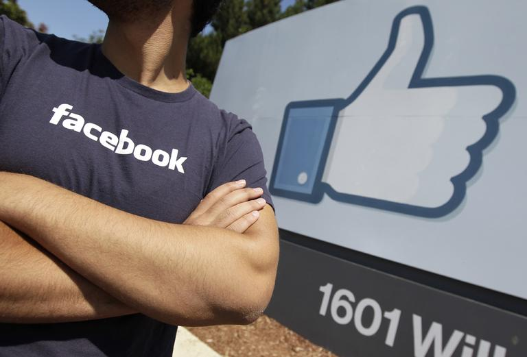 A Facebook worker outside of Facebook headquarters in Menlo Park, Calif. (AP)