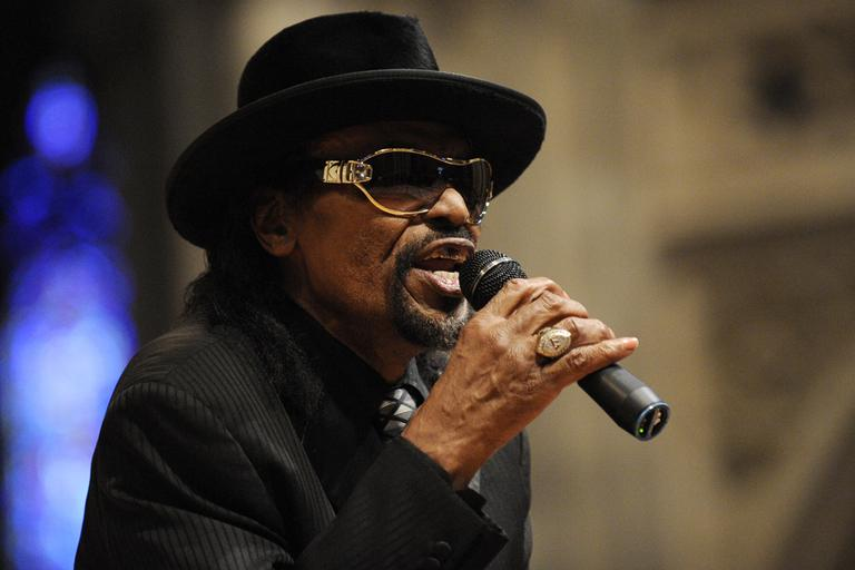 "In this Jan. 18, 2010 file photo, master of ceremonies Chuck Brown speaks during a program to celebrate the legacy of the late Martin Luther King, Jr. at the Washington National Cathedral in Washington. Brown, who styled a unique brand of funk music as a singer, guitarist and songwriter known as the ""godfather of go-go,"" died Wednesday, May 16, 2012 after suffering from pneumonia. He was 75. (AP)"