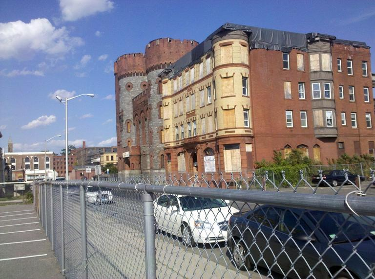 Two tornado-damaged buildings in the development area, including an old armory building MGM says it wants to preserve (Lynn Jolicoeur/WBUR)