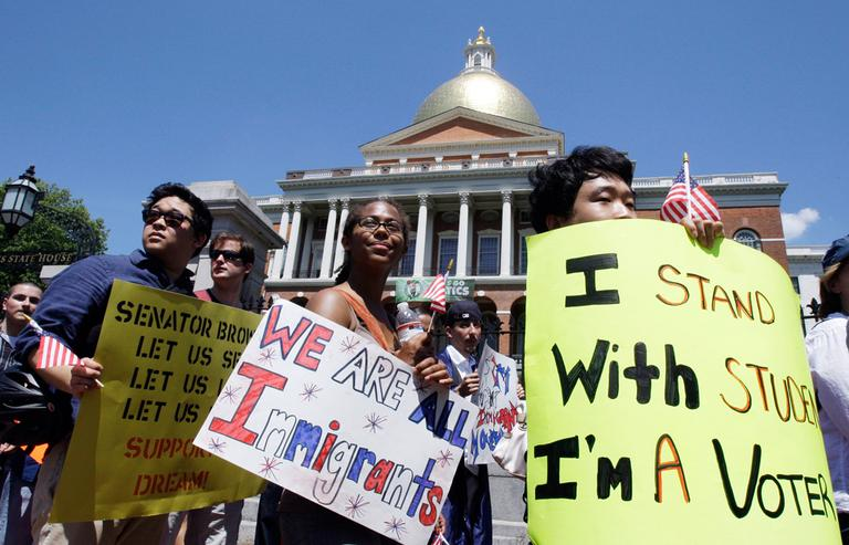 In this May 25, 2010, file photo, activists march from the State House en route to Sen. Scott Brown's office to ask for his support for the federal immigration law known as the DREAM Act. (AP File)