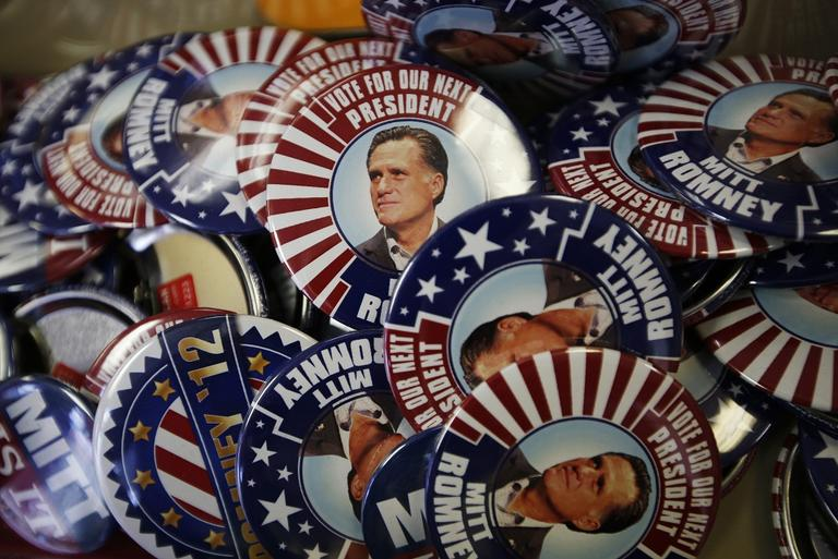 Campaign buttons of presidential candidate and former Massachusetts Gov. Mitt Romney are displayed ahead of the Republican National Convention in Tampa, Fla., on Sunday. (AP)