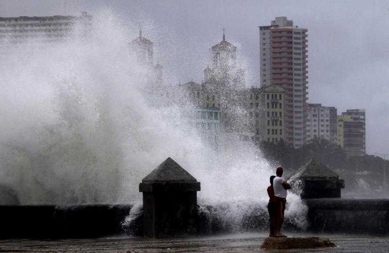 Waves pound the boardwalk during the passing of Tropical Storm Isaac in Havana Cuba, Sunday. (AP)