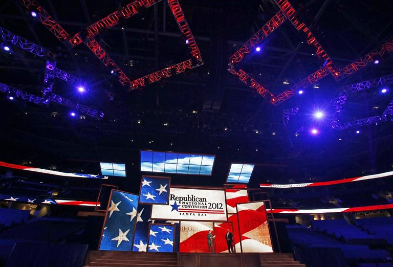 Republican National Committee Chairman Reince Priebus, left, and convention CEO William Harris unveil the stage and podium for the 2012 Republican National Convention last week. (AP/Scott Iskowitz)