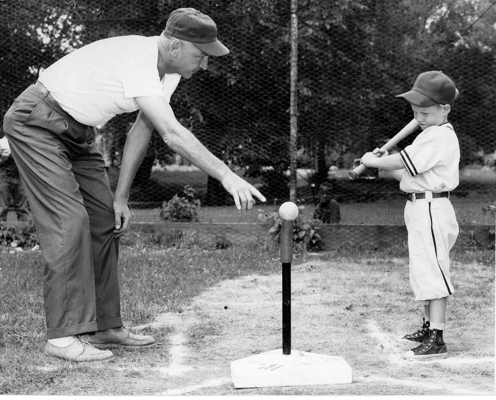 Jerry Sacharski, left, gives instructions to 5-year-old Craig LeClair in 1958. (AP/Frank Passic via Battle Creek Enquirer)