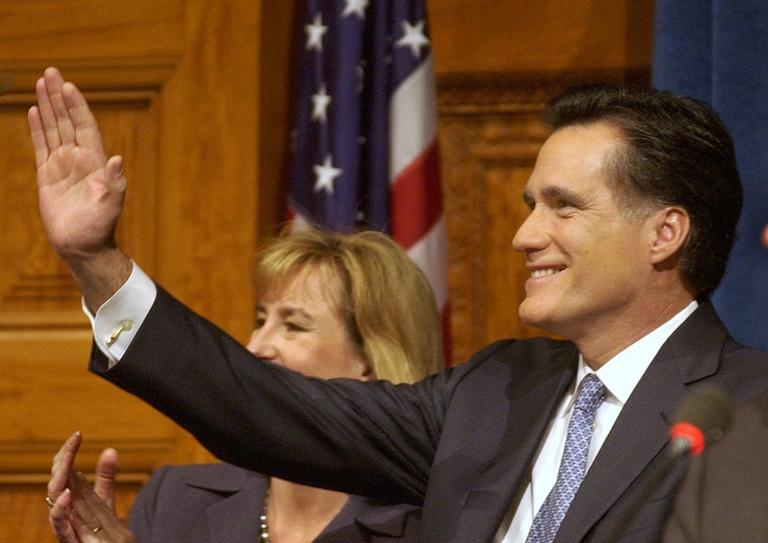 Massachusetts Gov. Mitt Romney waves after he and Lt. Gov. Kerry Murphy Healey, background, took their oaths of office during inaugural ceremonies at the Statehouse in Boston Thursday, Jan. 2, 2003. (AP /Elise Amendola)