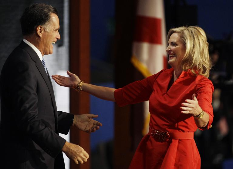 Ann Romney reaches out to hug her husband, Republican presidential nominee Mitt Romney, after she addressed the Republican National Convention in Tampa, Fla., on Tuesday. (AP)