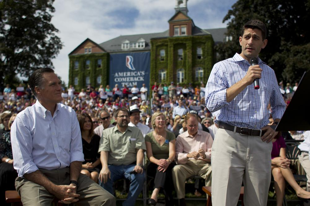Republican presidential candidate Mitt Romney, left, looks on as vice presidential running mate Paul Ryan, speaks during a campaign rally on Mon., Aug. 20, 2012 in Manchester N.H. (AP Photo)