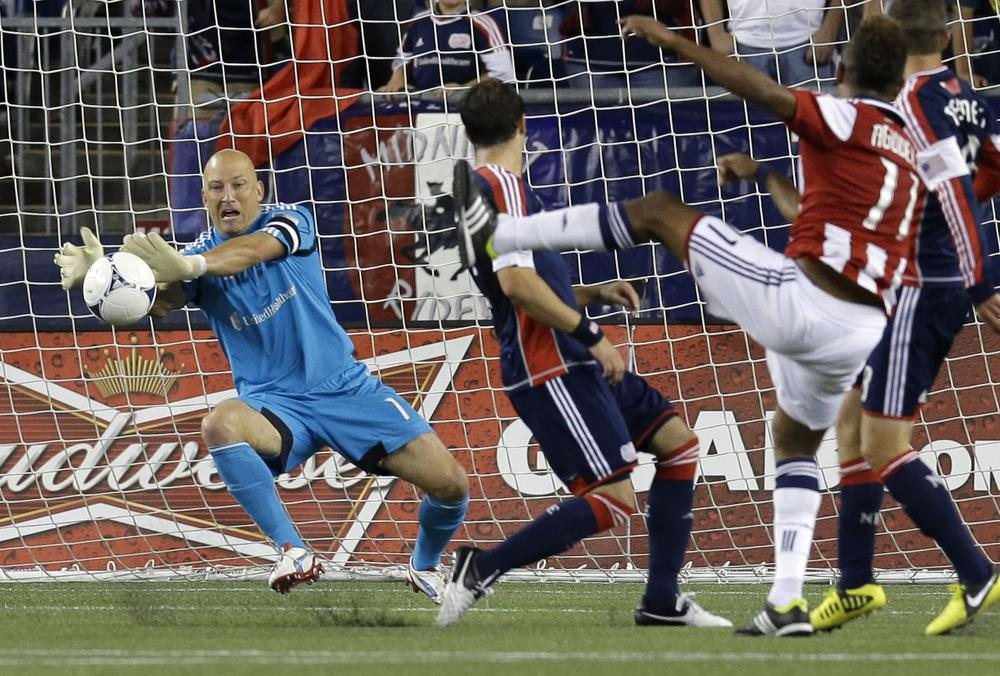 New England Revolution goalkeeper Matt Reis makes a save against a shot by Chivas USA forward Juan Agudelo during the second half of last night's match in Foxborough, which ended in a 3-3 tie. (AP Photo