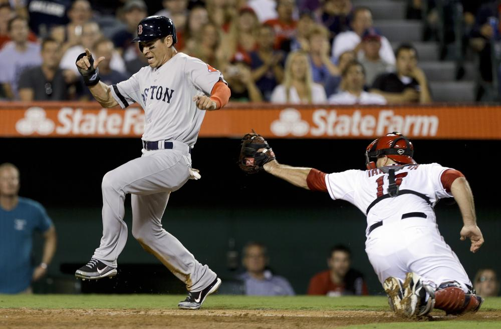 Boston's Jacoby Ellsbury scores past Los Angeles catcher Chris Iannetta on a hit by Dustin Pedroia during the fifth inning of last night's game in Anaheim. (AP Photo)