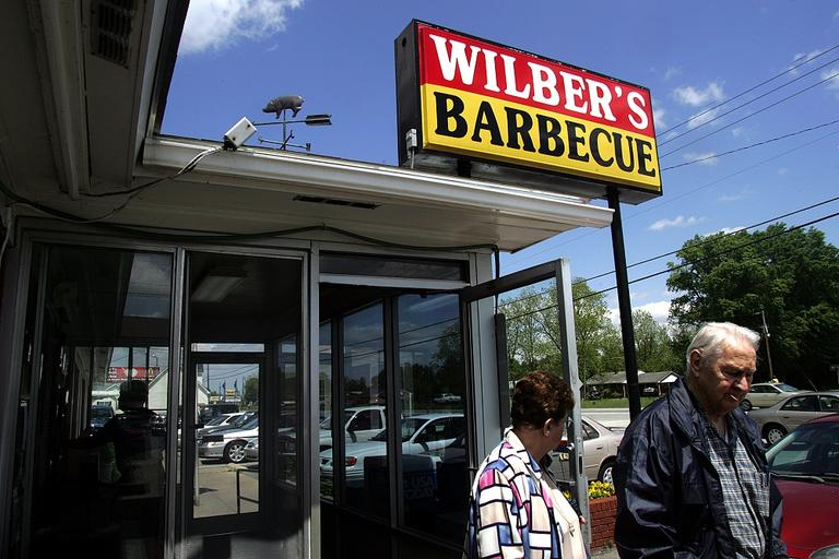Patrons leave Wilber's Barbecue in Goldsboro, N.C. in 2008. Wilber's uses vinegar-based BBQ sauce for an eastern North Carolina flavor. (AP/Jim R.Bounds)