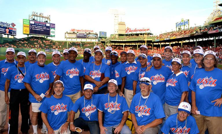 "EMASS Softball has been sending teams to Cuba annually since 2009 for exhibitions called ""The Friendship Games."" The teams posed for a photo after helping throw out the first pitch Saturday at Fenway Park. (Courtesy EMass Softball)"