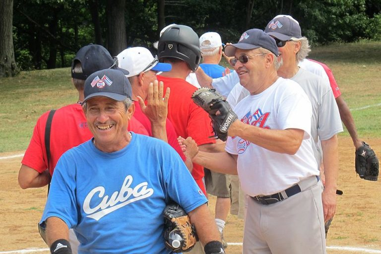 Wellesley resident Michael Eizenberg, right front, runs a business that offers cultural and educational trips. After organizing three EMASS Softball trips to Cuba, he coordinated the effort to bring a Cuban team to Boston. (Doug Tribou/WBUR)