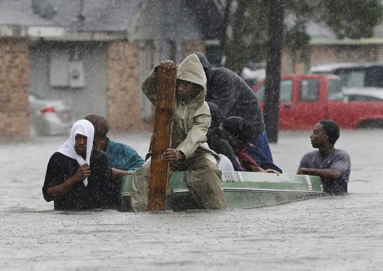 Residents evacuate their flooded neighborhood in LaPlace, La. on Thursday, a day after Hurricane Isaac hit the area. (AP)