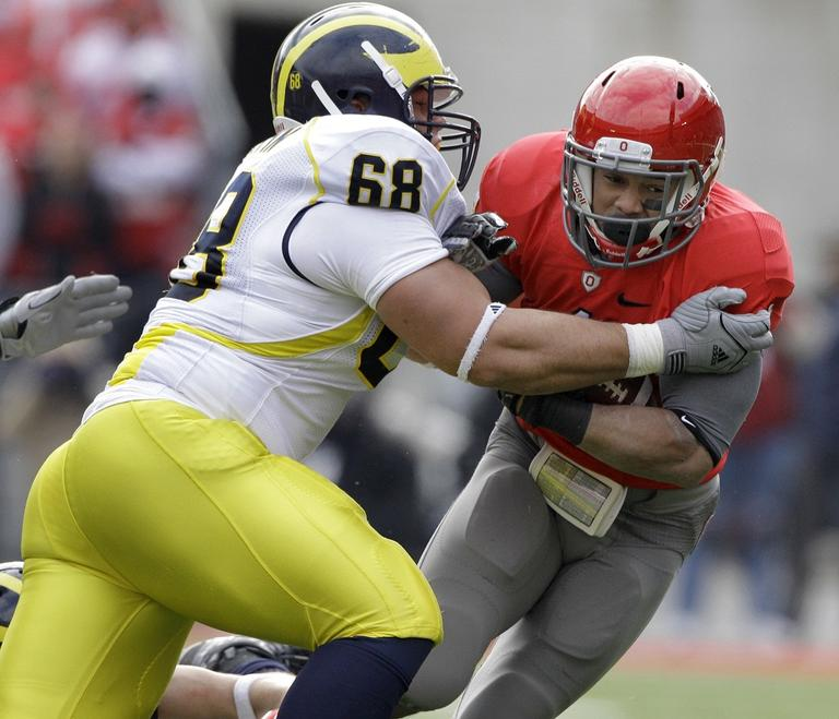 Ohio State running back Dan Herron (1) is tackled by University of Michigan defensive tackle Mike Martin (68) in 2010. (AP/Amy Sancetta)