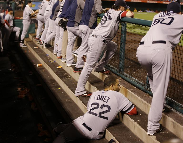 Boston Red Sox's James Loney watches the final inning of their baseball in the dugout against the Los Angeles Angels in Anaheim, Calif. Thursday. (2012)