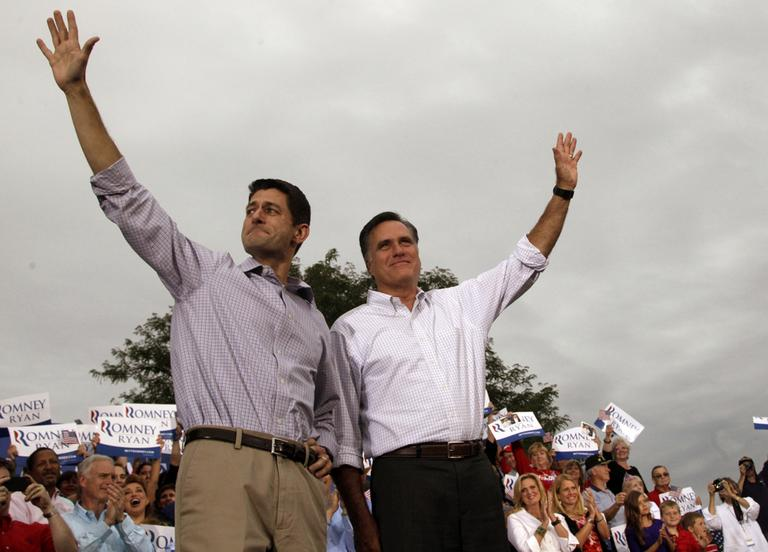 Republican presidential candidate, former Massachusetts Gov. Mitt Romney, right, and vice presidential running mate Rep. Paul Ryan of Wisconsin, greet the crowd during a campaign event at the Waukesha County Expo Center, Sunday, Aug. 12, 2012, in Waukesha, Wis. (AP)