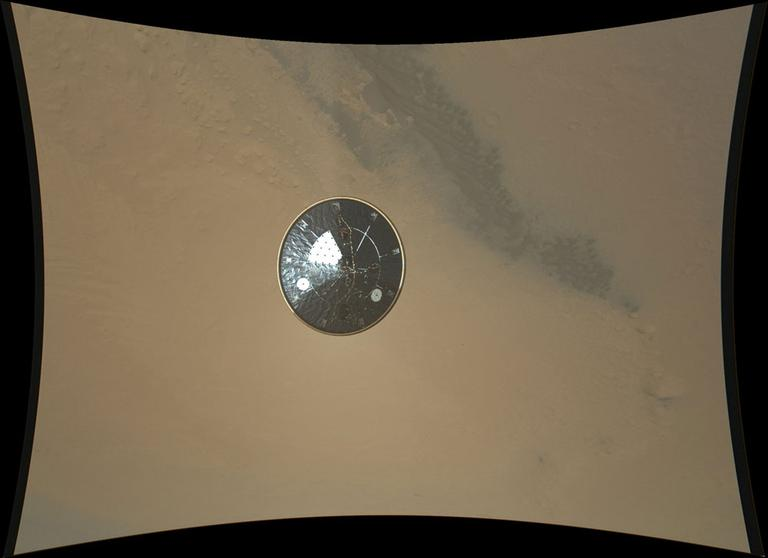 In this image released by NASA on Wednesday, Aug. 8, 2012, an image showing the heat shield of NASA's Curiosity rover, obtained during descent to the surface of Mars. The image was obtained by the Mars Descent Imager instrument known as MARDI and shows the 15-foot diameter heat shield when it was about 50 feet from the spacecraft. (AP/NASA)