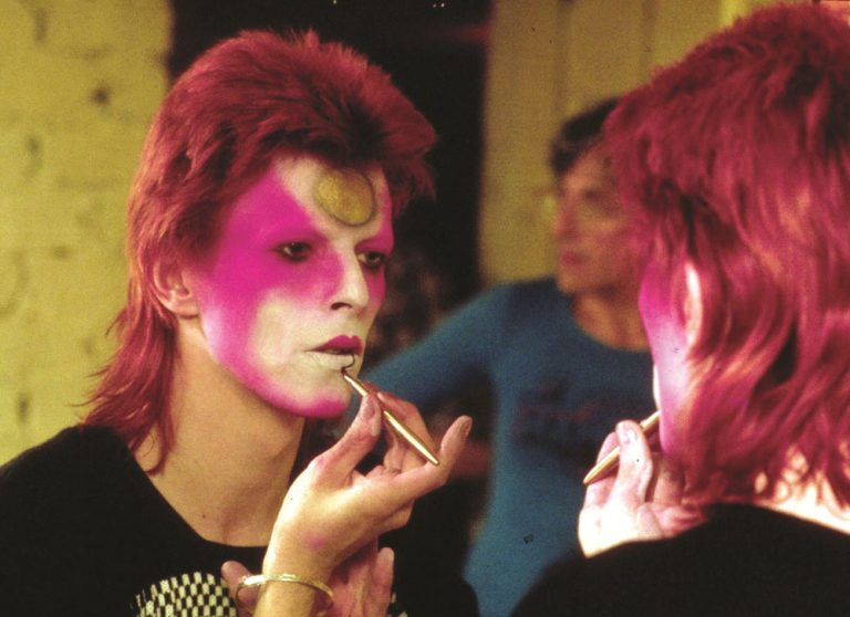 David Bowie applies his makeup. (R. Bamber/Rex Features/Courtesy Everett Collection)