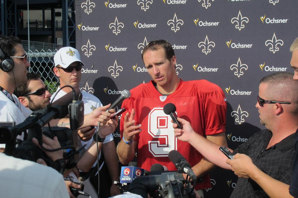 Saints quarterback Drew Brees speaks with members of the media. (Doug Tribou/WBUR)