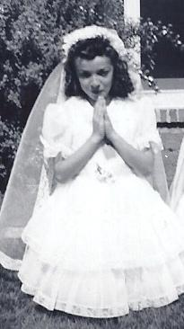 "The author at her first communion. Despite her complicated feelings about the church, ironically, she has been cast four times in her acting career as a nun, most recently as Sister Ricarda in ""The Three Stooges."" (Photo courtesy of Marianne Leone)"