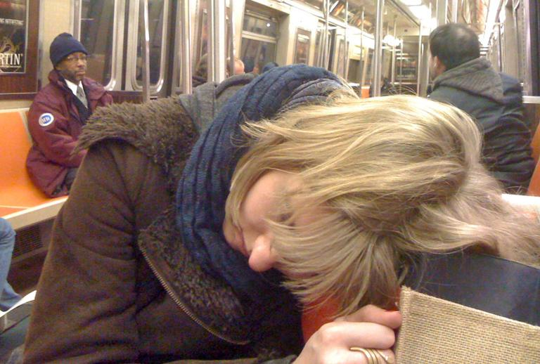 Sleeping on the subway. (MattHurst/Flickr)