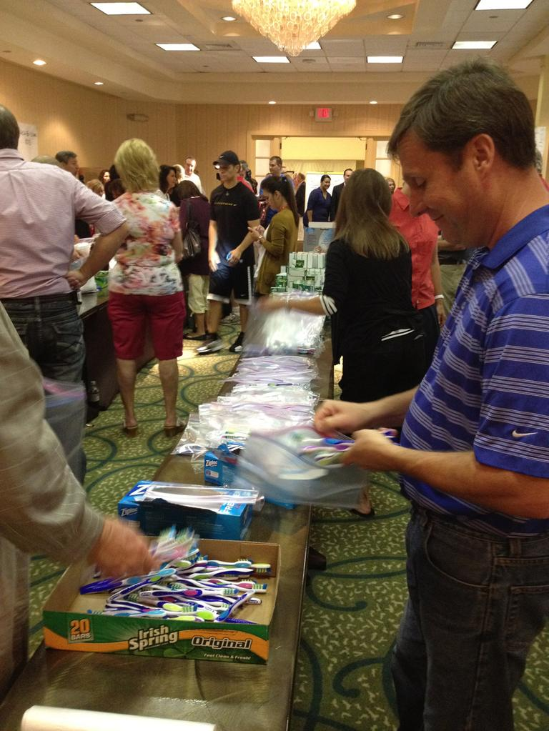 Mormon members of Utah's delegation crated hygiene bags for charity Monday at the RNC. (Meghan Keane/Here & Now)