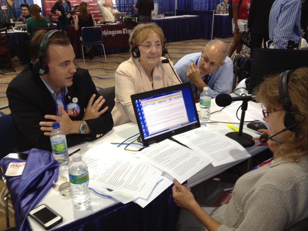 Mike Winder (left), LDS church member, and Carolyn Melby, a delegate from Frederick, Maryland and a convert to Mormonism, joined Robin on Radio Row in Tampa, Florida. (Here & Now)
