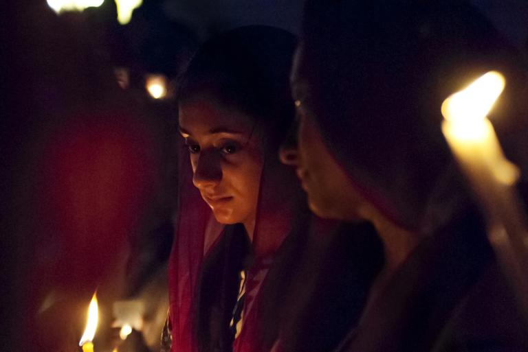 A woman holds a candle at a vigil held by the New England Sikh Society in Milford on Monday (Josh Berlinger for WBUR)