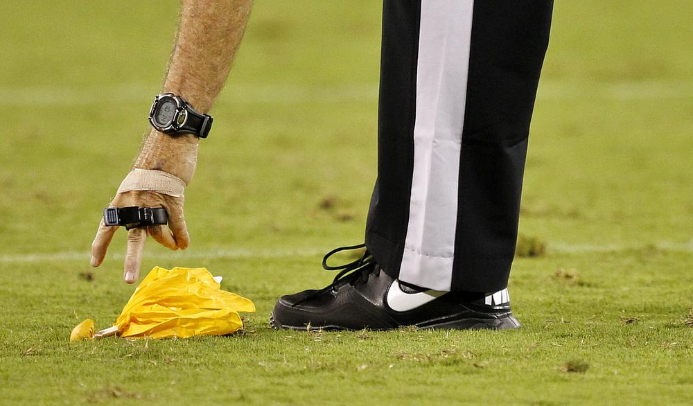 Yellow flags get a lot of attention, but they're a small part of the job description for NFL officials. (AP)