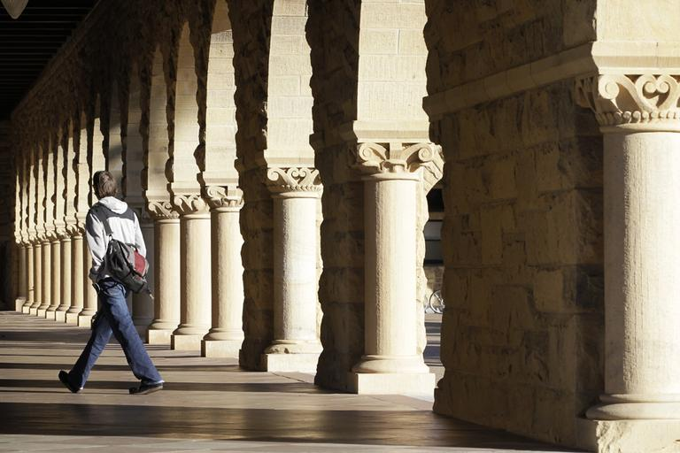 A Stanford University student walks though the halls of the Stanford University campus in Palo Alto, California. (AP)