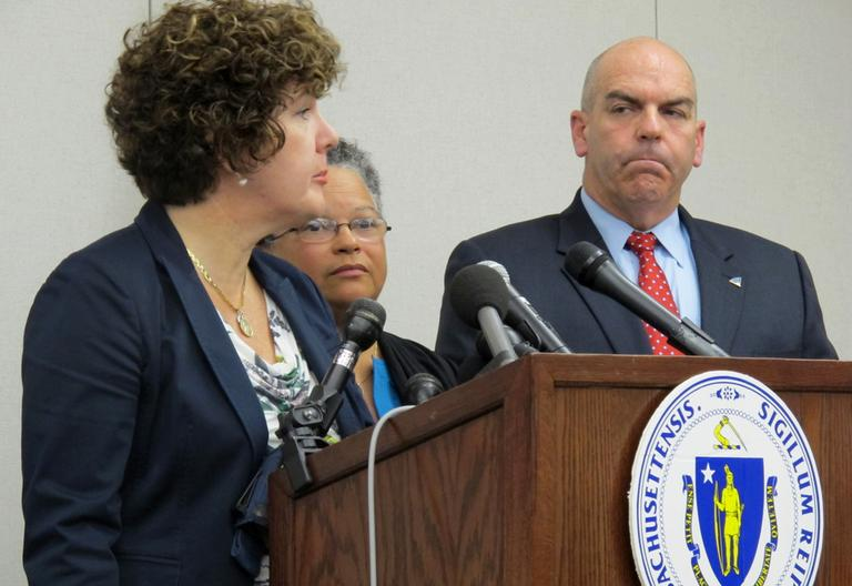 From left: Secretary of Public Safety Mary Beth Heffernan, Health and Human Services Secretary JudyAnn Bigby and State Police Col. Timothy Alben announce the lab firings Thursday. (Andrea Shea/WBUR)