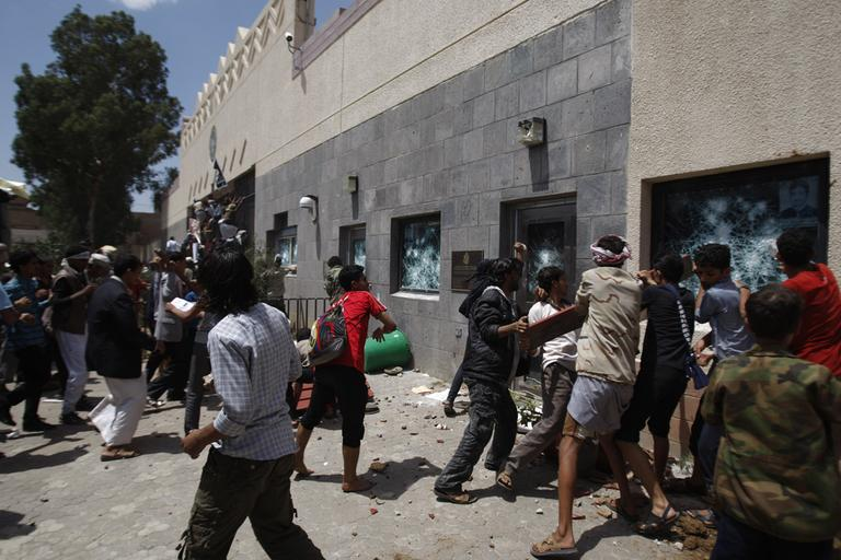 Yemeni protestors break windows of the U.S. Embassy during a protest about a film ridiculing Islam's Prophet Muhammad, in Sanaa, Yemen, Thursday. (AP)