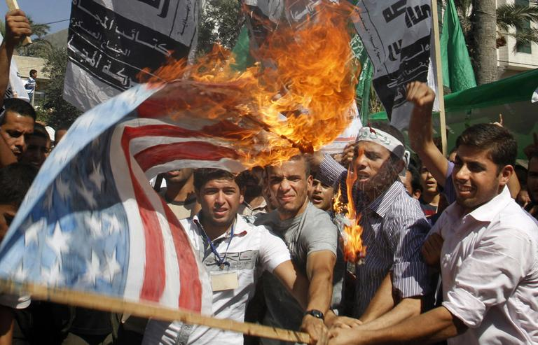 Palestinian Hamas supporters burn a U.S. flag during a protest in Gaza City, Friday, as part of widespread anger across the Muslim world about a film ridiculing Islam's Prophet Muhammad. (AP)