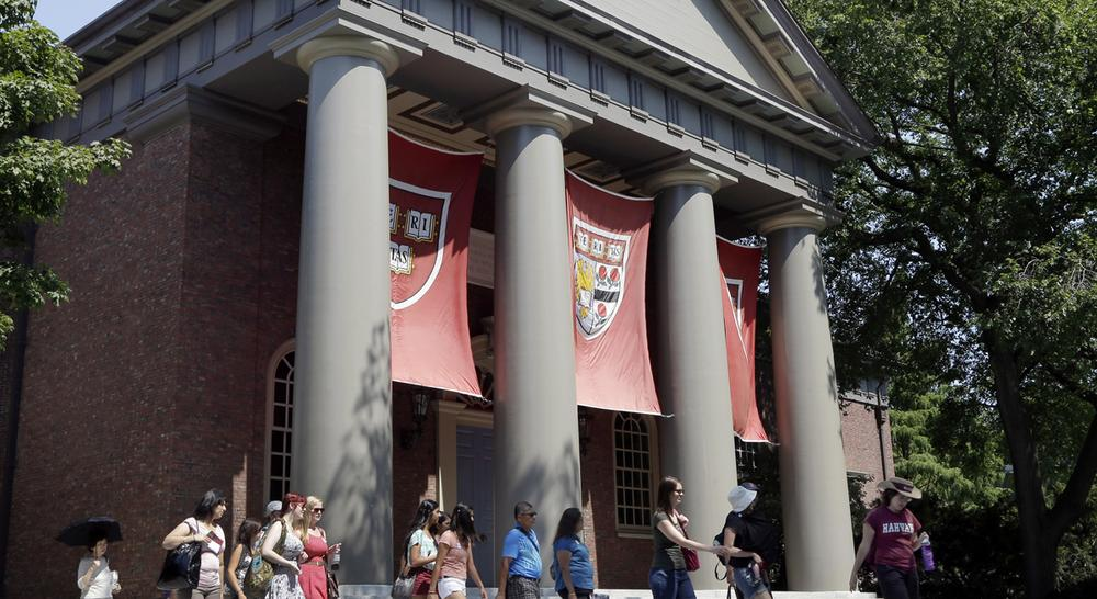 Harvard says it is taking a recent investigation into widespread cheating very seriously. But sportswriter Peter May says by buffering student athletes, the university is sending a very different message. (AP Photo)