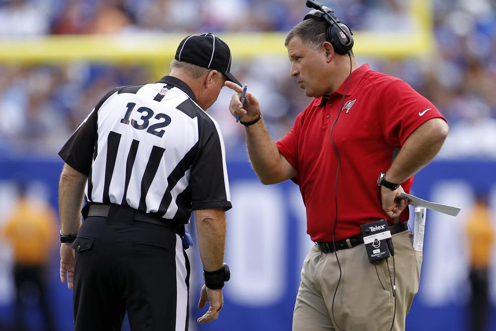 Coach Greg Schiano talks to referee John Parry during the Tampa Bay Buccaneers game against the New York Giants. Until the lockout of regular NFL referees ends, replacement refs will keep calling games. (AP)