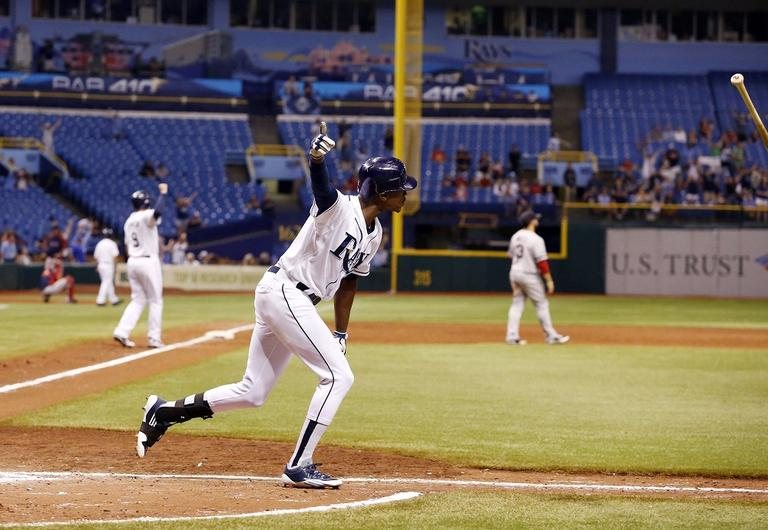 Tampa Bay Ray's B.J. Upton reacts after hitting the game winning home run in the bottom of the ninth inning to  give the Rays a 7-4 win over the Boston Red Sox . (AP/Scott Iskowitz)
