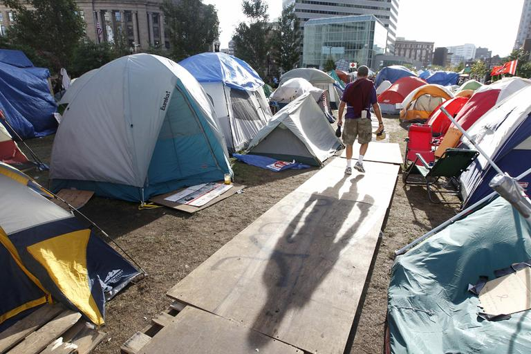 A man walks through the Occupy Boston encampment in the Financial District in Boston, Oct. 11, 2011. (AP)