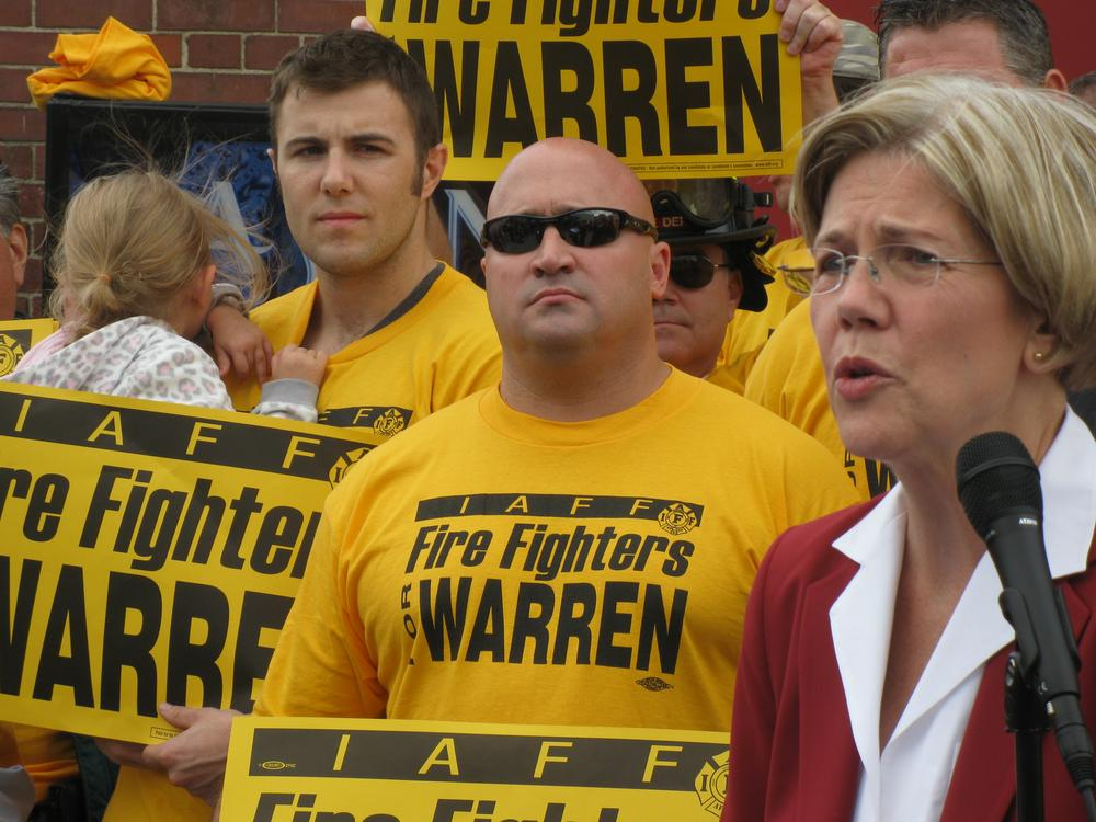 Democratic U.S. Senate candidate Elizabeth Warren accepts the endorsement of the Professional Fire Fighters of Massachusetts in South Boston Wednesday. (Fred Thys/WBUR)