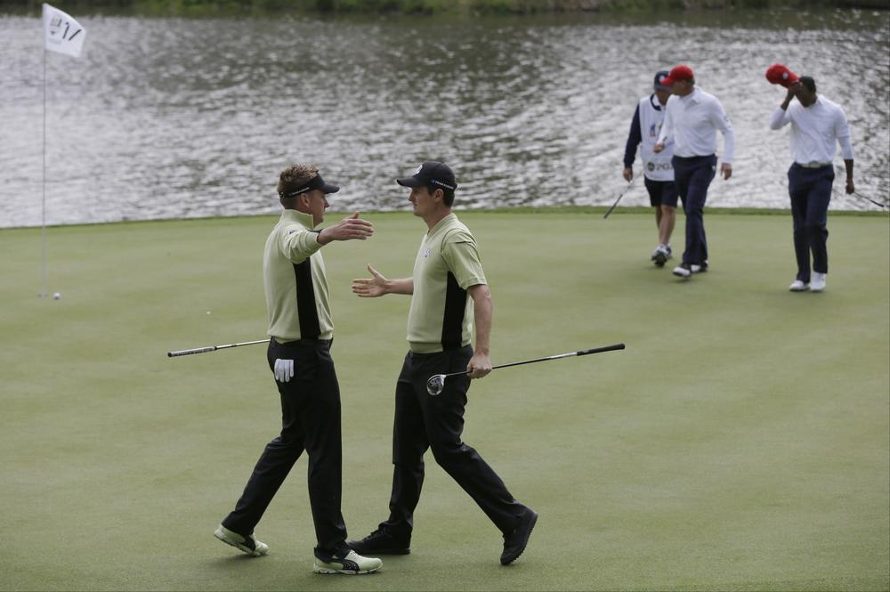 Pairs from the European and American teams competed in foursome play at the Ryder Cup golf tournament in Medinah, Ill. (AP)