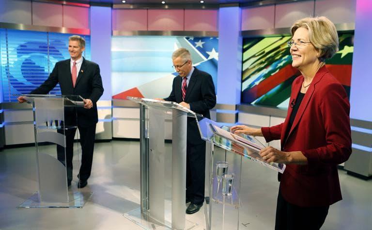 Sen. Scott Brown and his Democratic challenger Elizabeth Warren prepare for their first debate with moderator Jon Keller on Sept. 20 in Boston. (AP)