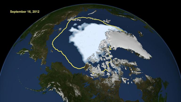 This image made available by NASA shows the amount of summer sea ice in the Arctic on Sunday, Sept. 16, 2012, at center in white, and the 1979 to 2000 average extent for the day shown, with the yellow line. (AP /U.S. National Snow and Ice Data Center)