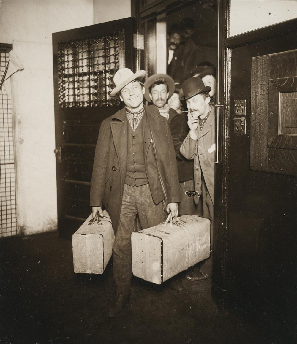 """Attributed to J. H. Adams, """"Races, Immigration: United States. New York. New York City. Immigrant Station: Regulation of Immigration at the Port of Entry. United States Immigrant Station, New York City: Saved at the Last Moment (Through an Appeal, the Order to Deport Was Revoked)"""" c. 1903. Glossy collodion silver print. Harvard Art Museums/Fogg Museum, Transfer from the Carpenter Center for the Visual Arts, Social Museum Collection, 3.2002.285.1. (Courtesy of Harvard Art Museums)"""
