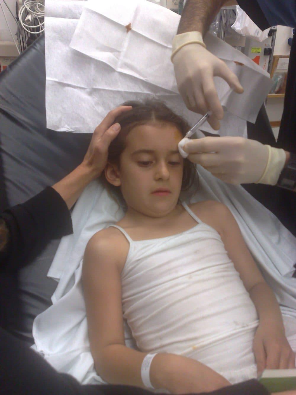 Julia getting a shot of Novocaine. (Courtesy of Rachel Zimmerman.)