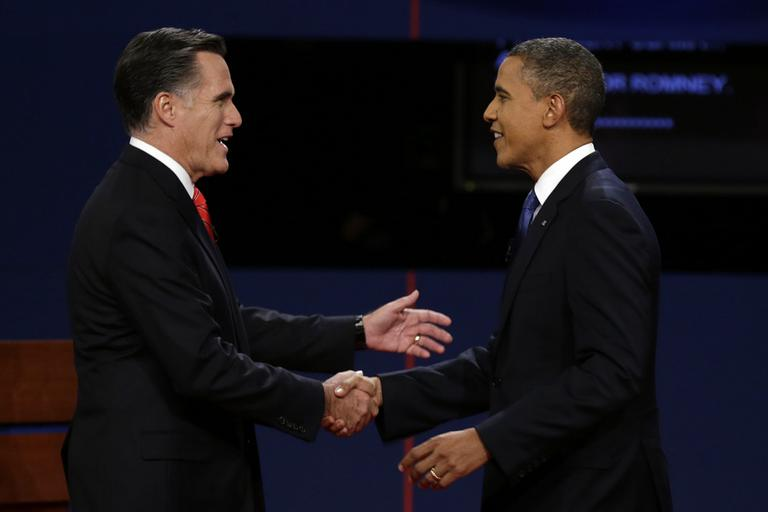 Republican presidential nominee Mitt Romney and President Obama shake hands before the first presidential debate at the University of Denver on Oct. 3. (Charlie Neibergall/AP)