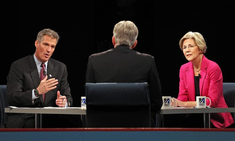 U.S. Sen. Scott Brown answers a question during a debate against challenger Elizabeth Warren Monday at the University of Massachusetts Lowell. Facing the candidates is moderator David Gregory. (AP/The Boston Herald, Pool)
