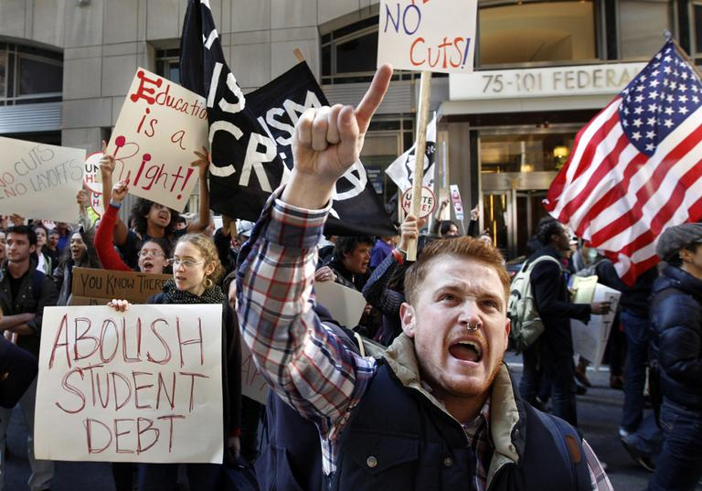 Keegan O'Brien joins with members of the Occupy Boston movement, students from area colleges and union workers as they march through downtown Boston, on Nov. 2, 2011. The march was held to protest the nation's growing student debt burden. (AP)