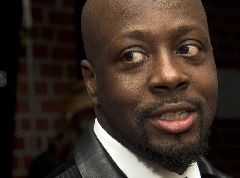 Wyclef Jean attends a party to benefit Donna Karan's Hope, Help and Rebuild Haiti charity, in New York, Tuesday, Sept, 20, 2011. (AP)