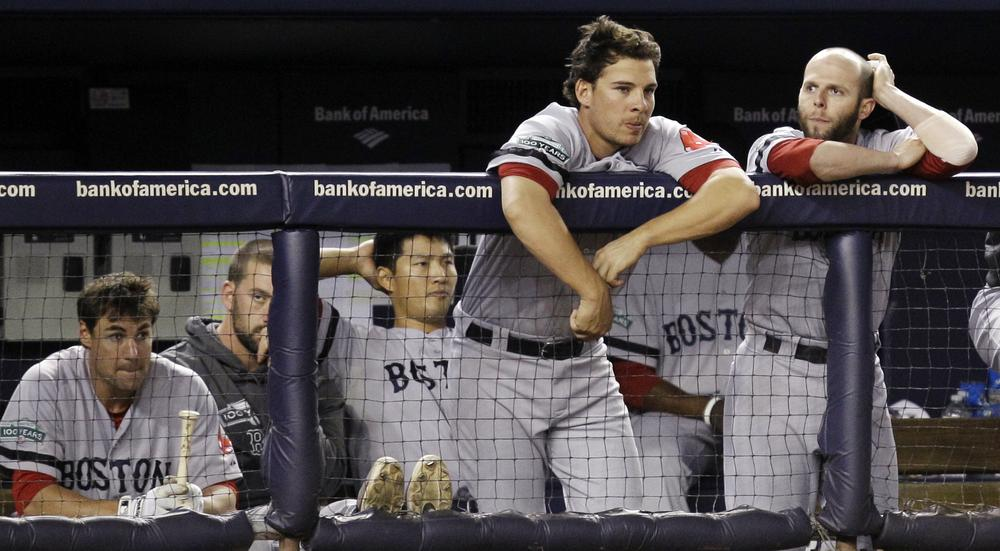 Sox players including Che-Husan Lin, third from left, and Danny Valencia and Dustin Pedroia, far right, watch from the dugout during their 10-2 loss to the Yankees in New York, Monday. (AP)