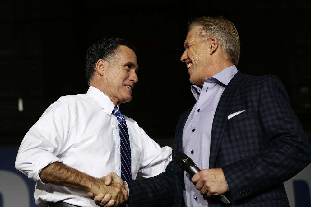Former NFL quarterback John Elway joined Republican presidential candidate Mitt Romney on the campaign trail. (AP/Charles Dharapak)