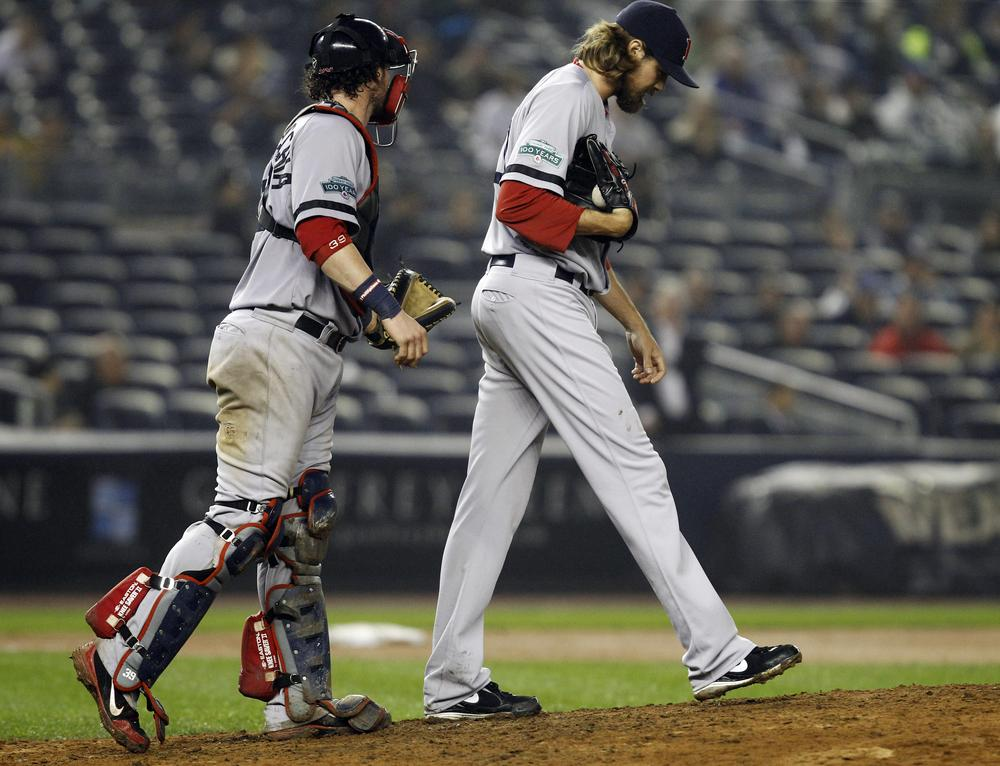 Red Sox catcher Jarrod Saltalamacchia, left, interacts with relief pitcher Andrew Miller in the 12th inning of their 4-3 loss to the Yankees in New York  Tuesday night. (AP)